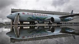 An Air Canada Boeing 777 painted in a 2010 Winter Olympic Games motive is unveiled in Vancouver, British Columbia July 8, 2009. REUTERS/Andy Clark