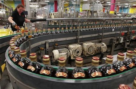 Bottles of Johnnie Walker whisky move along on the production line at the Diageo owned Shieldhall bottling plant in Glasgow, Scotland March 24, 2011. REUTERS/David Moir
