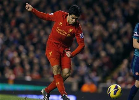 Liverpool's Luis Suarez scores his second goal against Sunderland during their English Premier League soccer match at Anfield in Liverpool, northern England January 2, 2013. REUTERS/Phil Noble