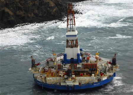The conical drilling unit Kulluk sits grounded 40 miles (64 kms) southwest of Kodiak City, Alaska in this U.S. Coast Guard handout photo taken January 3, 2012. REUTERS/U.S. Coast Guard/Petty Officer 2nd Class Zachary Painter/Handout