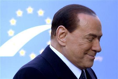 Italy's former Prime Minister Silvio Berlusconi arrives for a meeting of the European People's Party (EPP), ahead of a two-day European Union leaders summit, in Brussels December 13, 2012. After a hectic year of crisis management, during which Greece had a close brush with the euro zone exit, European Union leaders aim to strengthen banking oversight and work on wider reforms at their sixth summit of 2012 starting on Thursday. REUTERS/Eric Vidal (BELGIUM - Tags: POLITICS BUSINESS)