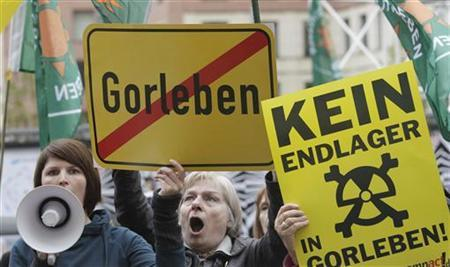 Protesters shout slogans before a meeting on nuclear waste storage facilities at the German Environmental Ministry in Berlin April 24, 2012. The sign (R) reads, ''No nuclear waste storage in Gorleben''. REUTERS/Tobias Schwarz (GERMANY - Tags: POLITICS ENVIRONMENT CIVIL UNREST)