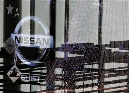 A logo of Nissan Motor Co is pictured past Christmas decorations at the company showroom in Yokohama, south of Tokyo December 5, 2012. Nissan's showroom traffic in China has nearly returned to levels seen a year earlier, before a diplomatic dispute led China consumers to boycott Japanese cars,Nissan Motor Co Chief Operating Officer Toshiyuki Shiga said on Wednesday. REUTERS/Yuriko Nakao (JAPAN - Tags: TRANSPORT BUSINESS LOGO)