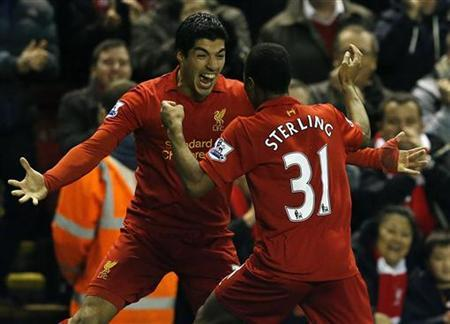 Liverpool's Raheem Sterling (R) celebrates his goal against Sunderland with Luis Suarez during their English Premier League soccer match at Anfield in Liverpool, northern England January 2, 2013. REUTERS/Phil Noble