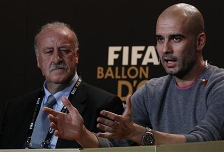 FIFA Men's Coach of the Year nominees Vicente del Bosque of Spain and his compatriot Pep Guardiola (R) address a news conference before the FIFA Ballon d'Or 2012 Gala at the Kongresshaus in Zurich January 7, 2013. REUTERS/Michael Buholzer