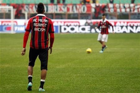 AC Milan's Kevin Prince Boateng (L), wearing a jersey against racism, and Stephan El Shaarawy warm up before their Serie A soccer match against Siena at San Siro stadium in Milan January 6, 2013. REUTERS/Giampiero Sposito