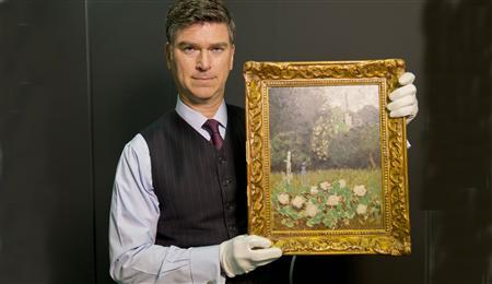 Christopher Marinello, executive director at the Art Loss Register in London, holds Henri Matisse's painting ''Le Jardin'' in this handout photo. REUTERS/Ray Wells/Handout