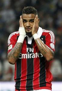 AC Milan's Kevin-Prince Boateng reacts after missing a goal opportunity against Inter Milan during their Italian Serie A soccer match at San Siro stadium in Milan October 7, 2012. REUTERS/Max Rossi