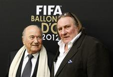 FIFA President Sepp Blatter is accompanied by French actor Gerard Depardieu (R) as he arrives before the FIFA Ballon d'Or 2012 Gala at the Kongresshaus in Zurich January 7, 2013. REUTERS/Arnd Wiegmann