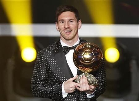 Lionel Messi of Argentina, FIFA World Player of the Year 2012 smiles as he holds his FIFA Ballon d'Or trophy during the FIFA Ballon d'Or 2012 soccer awards ceremony at the Kongresshaus in Zurich January 7, 2013. REUTERS/Michael Buholzer