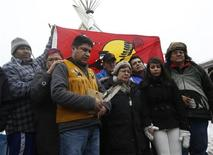 Attawapiskat Chief Theresa Spence (C) takes part in a news conference with supporters outside her teepee on Victoria Island in Ottawa January 4, 2013. REUTERS/Chris Wattie