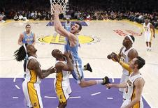 Denver Nuggets' Danilo Gallinari (C) of Italy shoots over Los Angeles Lakers', (L-R) Jordan Hill, Jodie Meeks, Dwight Howard and Steve Nash while Kobe Bryant (R) looks on from the rear during the second half of their NBA basketball game in Los Angeles January 6, 2013. Denver Nuggets' JaVale McGee (34) and Ty Lawson (3) are also seen in the rear. REUTERS/Danny Moloshok