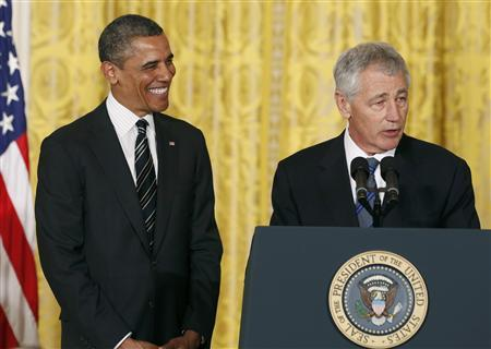U.S. President Barack Obama smiles at his nominee for Secretary of Defense, former Republican Senator Chuck Hagel (R), at the White House in Washington January 7, 2013. Obama announced the nominations of Hagel for defense secretary, and John Brennan as the next CIA director. REUTERS/Kevin Lamarque