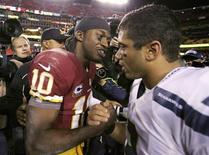 Seattle Seahawks quarterback Russell Wilson (3) is congratulated by Washington Redskins quarterback Robert Griffin III (10), following their NFL NFC wildcard playoff game in Landover, Maryland, January 6, 2013. REUTERS/Laurence Kesterson