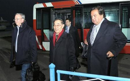 Former New Mexico Governor Bill Richardson (R) and Google Executive Chairman Eric Schmidt (L) arrive at an airport in Pyongyang, in this photo taken by Kyodo January 7, 2013. REUTERS/Kyodo