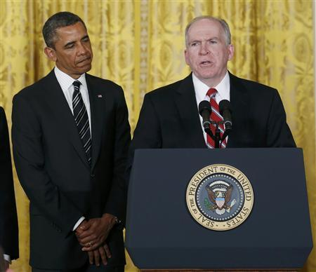 U.S. President Barack Obama (L) stands next to John Brennan, (R), during the announcement for his nominations for a new secretary of defense and new CIA director at the White House in Washington January 7, 2013. REUTERS/Kevin Lamarque