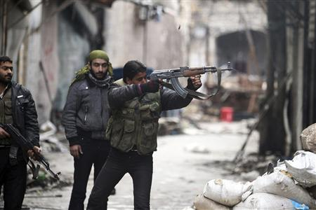 A Free Syrian Army fighter fires his weapon towards positions occupied by forces loyal to Syria's President Bashar al-Assad in the old city of Aleppo January 7, 2013. REUTERS/Muzaffar Salman