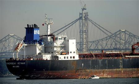 The 750-foot-long tanker ''Overseas Reymar'' lies at anchor after striking a support pylon of the San Francisco Bay Bridge, seen in background, in San Francisco, California January 7, 2013. REUTERS/Noah Berger