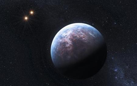 An artist's rendering image released to Reuters on October 19, 2009 shows an exoplanet 6 times the Earth-size circulating around its low-mass host star at a distance equal to 1/20th of the Earth-Sun distance. REUTERS/ESO/L. Calcada/Handout/Files