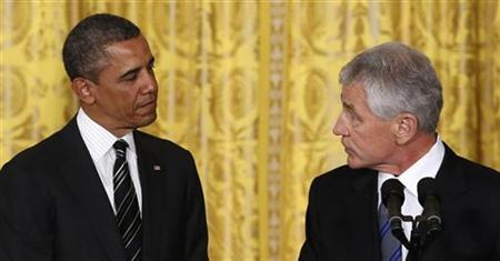 Former U.S. Senator Chuck Hagel (R) takes the podium after U.S. President Barack Obama announced the nomination of Hagel to be his new Secretary of Defense, at the White House in Washington January 7, 2013. REUTERS/Kevin Lamarque