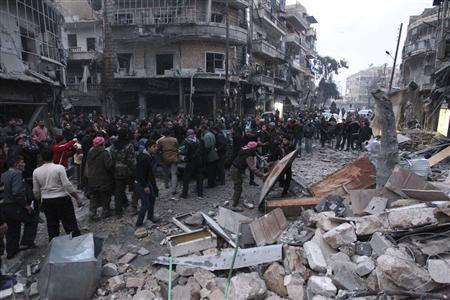 Civilians and Free Syrian Army fighters gather at the site hit by a missile in Aleppo's al-Mashhad district January 7, 2013. REUTERS/Muzaffar Salman
