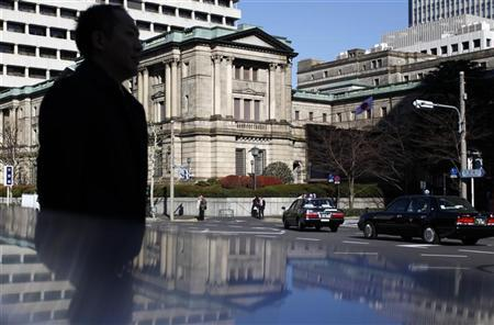 A man walks past the headquarters of the Bank of Japan in Tokyo December 20, 2012. REUTERS/Yuya Shino