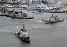 Japan Maritime Self-Defense Force's (JMSDF) Aegis destroyers Myoko (L) and Kongo sail off from the JMSDF Sasebo base in Sasebo, southern Japan, in this photo taken by Kyodo December 6, 2012. REUTERS/Kyodo