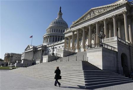 The U.S. Capitol Dome is seen behind the entrance to the U.S. Senate (R) on Capitol Hill in Washington, November 9, 2012. REUTERS/Larry Downing/Files