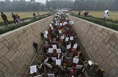 Women carrying placards enter Raj Ghat to attend a prayer ceremony for a rape victim after a rally organized by Delhi Chief Minister Sheila Dikshit (unseen) protesting for justice and security for women, in New Delhi January 2, 2013. REUTERS/Adnan Abidi