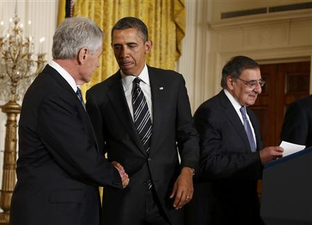 U.S. President Barack Obama (C) greets his Defense Secretary-nominee, former U.S. Senator Chuck Hagel, as current Defense Secretary Leon Panetta (R) takes the podium prior to the president anouncing Hagel's nomination at the White House in Washington January 7, 2013. REUTERS/Jason Reed