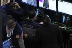 Traders work at the Greywolf trading stall on the floor of the New York Stock Exchange, January 7, 2013. REUTERS/Brendan McDermid (UNITED STATES - Tags: BUSINESS)
