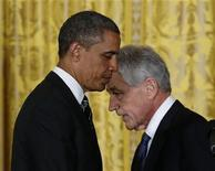 Former U.S. Senator Chuck Hagel (R) walks past U.S. President Barack Obama (L) after Obama announced the nomination of Hagel to be his new Secretary of Defense, at the White House in Washington January 7, 2013. REUTERS/Kevin Lamarque (UNITED STATES - Tags: POLITICS TPX IMAGES OF THE DAY)