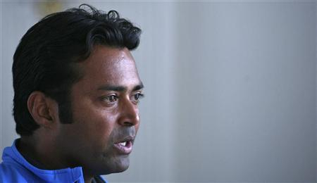 India's tennis player Leander Paes speaks during an interview with Reuters at the Delhi Lawn Tennis Association (DLTA) stadium in New Delhi February 5, 2012. REUTERS/Parivartan Sharma