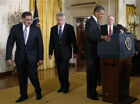 Current U.S. Secretary of Defense Leon Panetta (L), new Secretary of Defense nominee former Republican U.S. Senator Chuck Hagel (2nd L), U.S. President Barack Obama and new CIA Director nominee White House counterterrorism adviser John Brennan (R) arrive for a news conference in the East Room of the White House in Washington January 7, 2013. REUTERS/Jason Reed (UNITED STATES - Tags: POLITICS MILITARY)