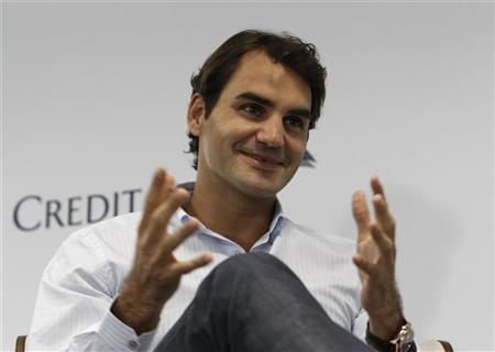 Tennis player Roger Federer of Switzerland speaks during a media event in Singapore January 4, 2013. REUTERS/Edgar Su