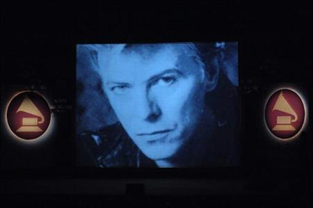 An image of David Bowie is projected on screen as it was announced he had won a Lifetime Achievement Award at the Grammy Special Merit Awards and Nominee Reception held at the Wilshire Ebell Theatre in Los Angeles, California February 7, 2006. REUTERS/Phil McCarten/Files