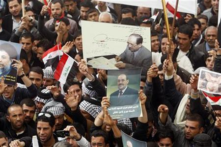 Supporters of Iraqi Prime Minister Nuri al-Maliki shouts slogans during a demonstration in Basra , 420 km (261 miles) southeast of Baghdad January 8, 2013. REUTERS/Atef Hassan