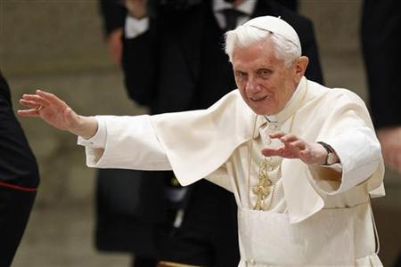 Pope Benedict XVI waves after leading his Wednesday general audience in Paul VI's Hall at the Vatican January 2, 2013. REUTERS/Giampiero Sposito