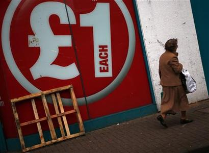 A woman walks past a discount shop in Leicester, central England, January 8, 2013. REUTERS/Darren Staples