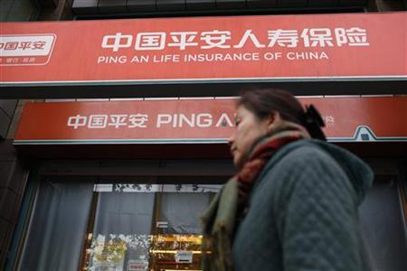 A woman walks past a Ping An Insurance building in Shanghai December 6, 2012. REUTER/Aly Song