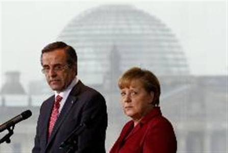 Greek Prime Minister Antonis Samaras (L) and German Chancellor Angela Merkel address the media before a bilateral meeting at the Chancellery in Berlin Januray 8, 2013. REUTERS/Fabrizio Bensch
