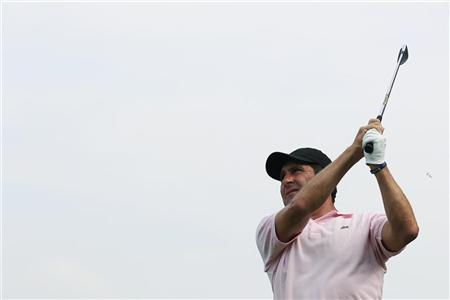 Jose Maria Olazabal of Spain tees off on the second hole during the first day of the Hong Kong Open golf tournament November 15, 2012. REUTERS/Tyrone Siu