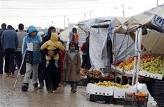 Rifugiati siriani nel campo profughi Al-Zaatari nella città giordana di Mafraq. REUTERS/Ali Jarekji