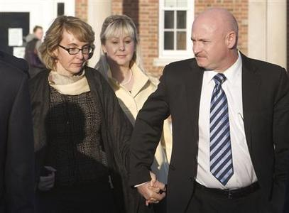 Former U.S. Representative Gabrielle Giffords (L) and her husband, former astronaut Mark Kelly, leave the Newtown Municipal Building in Newtown, Connecticut in this file photo taken January 4, 2013. Giffords, who was severely wounded two years ago in an Arizona shooting, is launching a group called Americans for Responsible Solutions with her husband, according to an ABC News report. REUTERS/Michelle McLoughlin/Files