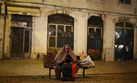 A homeless man listens to his radio at Figueira square in Lisbon December 24, 2012. REUTERS/Rafael Marchante