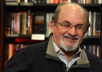 Author Salman Rushdie gestures during an interview with Reuters in central London, September 28, 2012. REUTERS/Paul Hackett