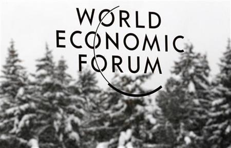 A logo of the World Economic Forum (WEF) is seen stuck on a window at the congress center in the Swiss mountain resort of Davos January 23, 2012. The upcoming WEF will be held from January 25 to 29. REUTERS/Christian Hartmann