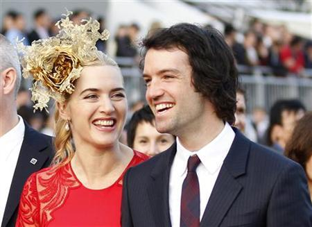 British actress Kate Winslet (L) and her husband Rocknroll attend a promotional event for the Hong Kong international races in Hong Kong in this December 9, 2012 file photo. REUTERS/Tyrone Siu/Files
