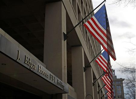The main headquarters of the FBI, the J. Edgar Hoover Building, is seen in Washington in this file photo taken March 4, 2012. The FBI's move to replace its cramped, crumbling and outmoded downtown headquarters has sparked a cross-border fight among local governments in Virginia, Maryland and the capital. Eager for the FBI's prestige and a plum deal in a slumping real estate market, local officials are plotting strategies and lining up congressional support to try to land the project. REUTERS/Gary Cameron/Files