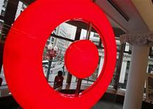 An employee at the new CityTarget store sits in a store window overlooking downtown Chicago, as they prepare for the opening, July 18, 2012. REUTERS/Jim Young